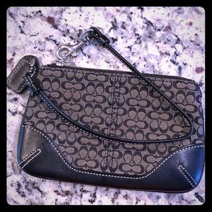 Small, black coach wristlet